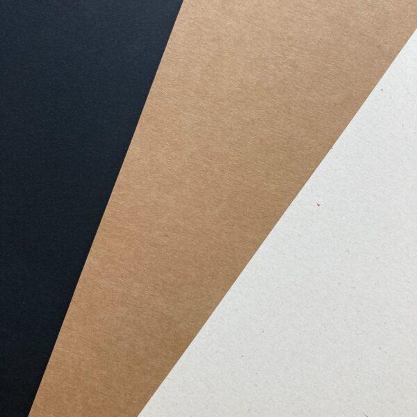 papier czarny, brązowa tektura i kremowy